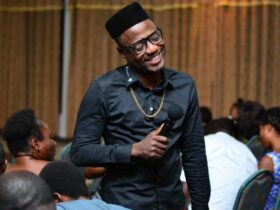 I've not profited from comedy, my parents still take care of me ~ Foster Romanus