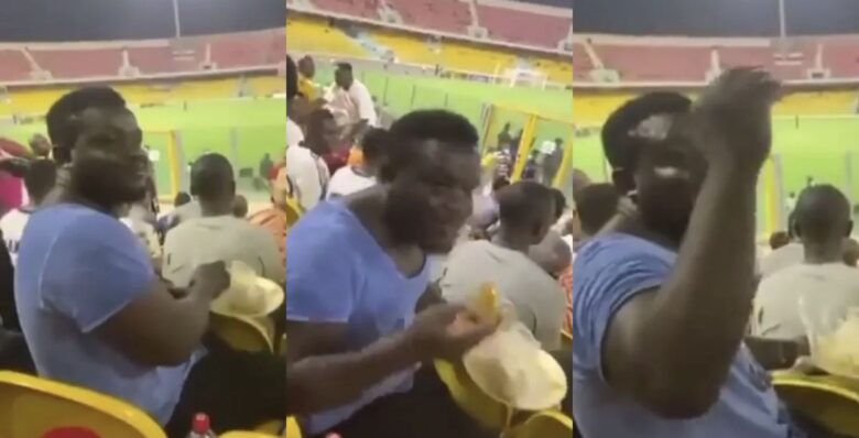 Accra Hearts of Oak Fan was spotted eating Banku and okro soup in the stadium